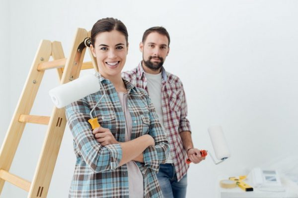 a couple repainting a home
