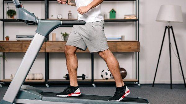 a man running on a treadmill indoors