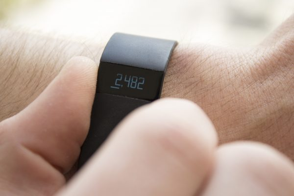 a man tracking his steps with his smart watch