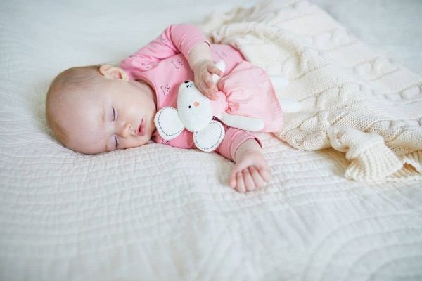 A cute baby fast asleep