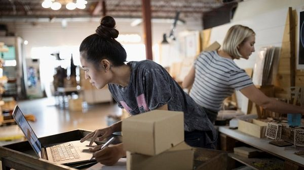 Two girls busy working in a workshop