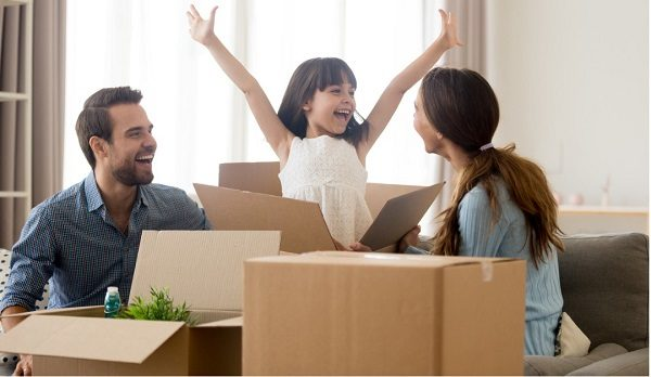 A happy family packing for a move