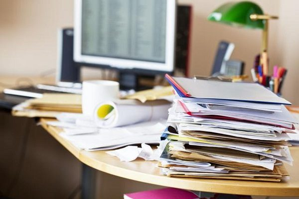 A cluttered office desk